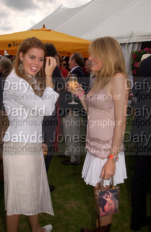 Princess Beatrice and Eliza Pearson, Veuve Clicquot gold Cup, Polo at cowdray, 18 July 2004. SUPPLIED FOR ONE-TIME USE ONLY> DO NOT ARCHIVE. © Copyright Photograph by Dafydd Jones 66 Stockwell Park Rd. London SW9 0DA Tel 020 7733 0108 www.dafjones.com