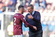Heart of Midlothian manager Craig Levein congratulates Michael Smith (#2) of Heart of Midlothian FC after the final whistle of the Ladbrokes Scottish Premiership match between Heart of Midlothian and Rangers FC at Tynecastle Park, Edinburgh, Scotland on 20 October 2019.