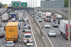 &copy; Licensed to London News Pictures. 20/07/2018<br /> DARTFORD, UK.<br /> Frantic Friday traffic madness on the M25 in Dartford,Kent.  (left)Anti clock-wise traffic very heavy.<br /> (Right) Clock-wise traffic into Kent.<br /> Photo credit: Grant Falvey/LNP