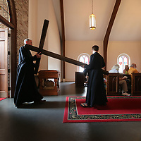 All Saints Episcopal Church carries a cross into their Good Friday Service Friday afternoonas part of their Good Friday Liturgy service.
