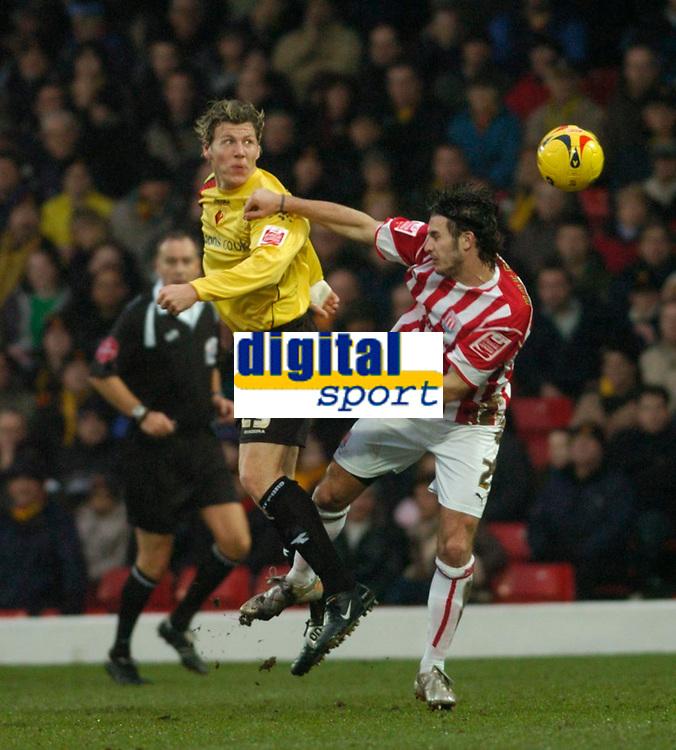 Photo: Leigh Quinnell.<br /> Watford v Stoke City. Coca Cola Championship.<br /> 14/01/2006. Watfords Darius Henderson rises above Stokes Carl Hoefkens.