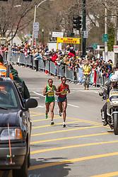 2014 Boston Marathon: lead pack of elite women race passes mile 19 in the Newton Hills, Rita Jeptoo