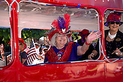 Members of the Red Hat Society march in the Veterans Day Parade, which honors American military veterans, in Tucson, Arizona, USA.