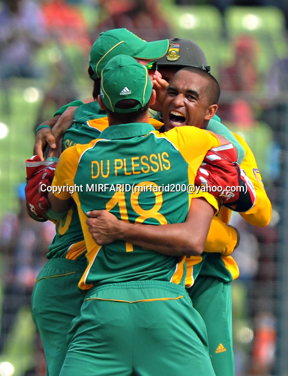 Robin Petersen celebrates the wicket of Brendan McCullam during the ICC Cricket World Cup quarter final match between South Africa and New Zealand held at the Shere Bangla National Stadium, Mirpur, Bangladesh on the 25 March 2011<br />