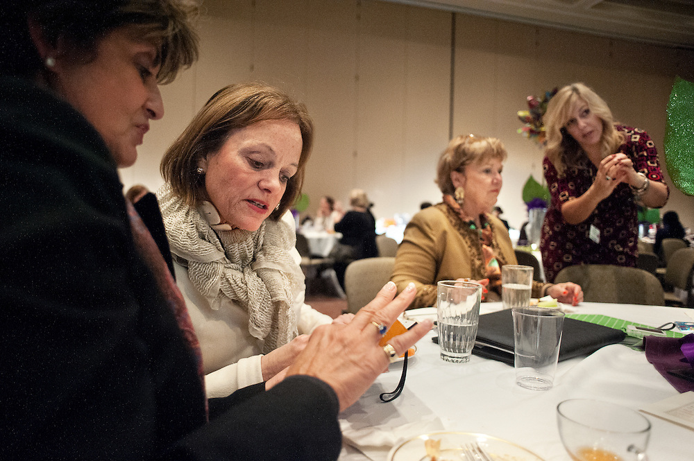 Luci Schey (left) Debbie Phillips Bower (second from left) Gwen Weiche (second from right) and Tracey Medley (right) talk during a networkign session at the Women in Philanthropy conference on Thursday, March 14th in Baker Ballroom.Photo by: Ross Brinkerhoff.