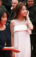 Kim Sae Ron and  July Jung, at the Foxcatcher gala screening red carpet at the 67th Cannes Film Festival France. Monday 19th May 2014 in Cannes Film Festival, France.