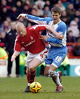 Photo: Leigh Quinnell.<br /> Nottingham Forest v Swindon Town. Coca Cola League 1. 25/02/2006. Swindons Stef Miglioranzi battles with Notingham Forests Gary Holt.