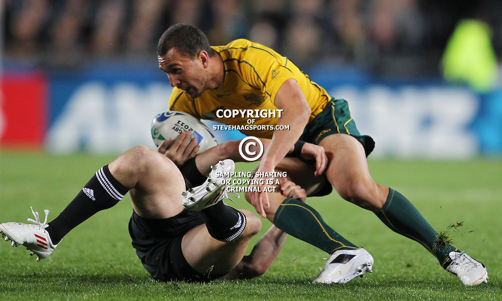 AUCKLAND, NEW ZEALAND - OCTOBER 16, Cory Jane  with a tackle on Quade Cooper during the 2011 IRB Rugby World Cup Semi Final match between New Zealand and Australia at Eden Park on October 16, 2011 in Auckland, New Zealand<br /> Photo by Steve Haag / Gallo Images