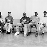 Volunteers in the Angola Prison Hospice program wait for their monthly meeting to begin inside a chapel that was built for the hospice program. There are 35-40 hospice volunteers, all of whom are certified as hospice care-givers. From left to right: Steven Garner, Morris Oselen, Vashon Kelly, Diego Zapata, Robert Matthews, Alton Walters, Lawrence Jenkins,. Isaac Turner, Troy Slater.