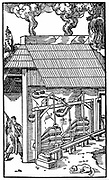 Bellows operated by camshaft powered by  water wheel. (just visible at extreme right) supplying draught to a smelting furnace. This application of the medieval invention of the cam enabled both bellows to be powered by the same water wheel. From Agricola 'De re metallica' Basle 1556. Woodcut