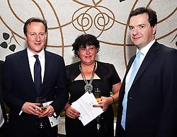 Prime Minister David Cameron and Chancellor George Osborne with Denise Harris, the founder of Afghan Heroes at a fundraising event for the charity in London,   Wednesday, 14th November 2102.  Photo by: Stephen Lock / i-Images