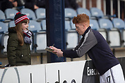 3rd February 2018, Dens Park, Dundee, Scotland; Scottish Premier League football, Dundee versus Ross County; Simon Murray of Dundee signs an autograph for a yougn fan