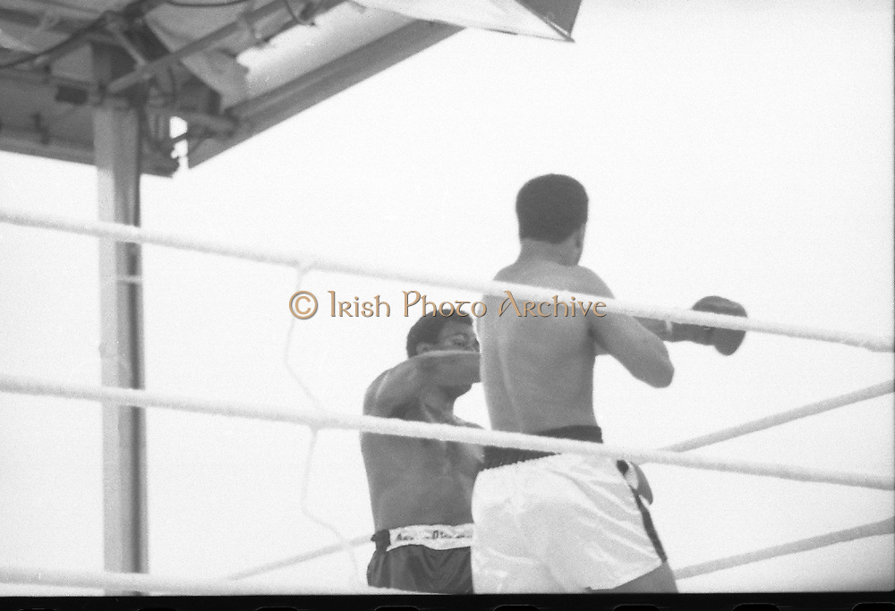 Ali vs Lewis Fight, Croke Park,Dublin.<br /> 1972.<br /> 19.07.1972.<br /> 07.19.1972.<br /> 19th July 1972.<br /> As part of his built up for a World Championship attempt against the current champion, 'Smokin' Joe Frazier,Muhammad Ali fought Al 'Blue' Lewis at Croke Park,Dublin,Ireland. Muhammad Ali won the fight with a TKO when the fight was stopped in the eleventh round.<br /> <br /> Ali lands a left to the side of Lewis's head