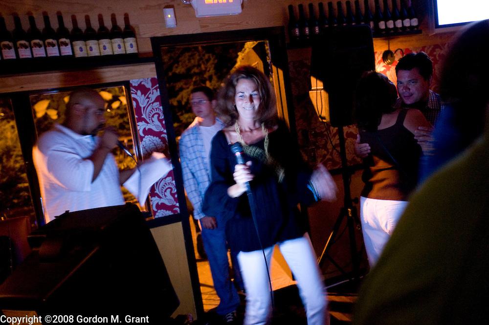 Wainscott, NY - 8/9/08 -    Patrons sing karaoke at Almoncello  in Wainscott, NY August 9, 2008.  (Photo by Gordon M. Grant)