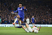 Chelsea attacker Willian (22) hurdling a challange during the Champions League match between Chelsea and Paris Saint-Germain at Stamford Bridge, London, England on 9 March 2016. Photo by Matthew Redman.