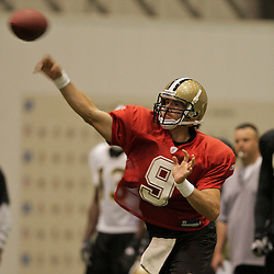 10 August 2009: New Orleans Saints quarterback Drew Brees (9) passes the ball during New Orleans Saints training camp at the team's indoor practice facility in Metairie, Louisiana.