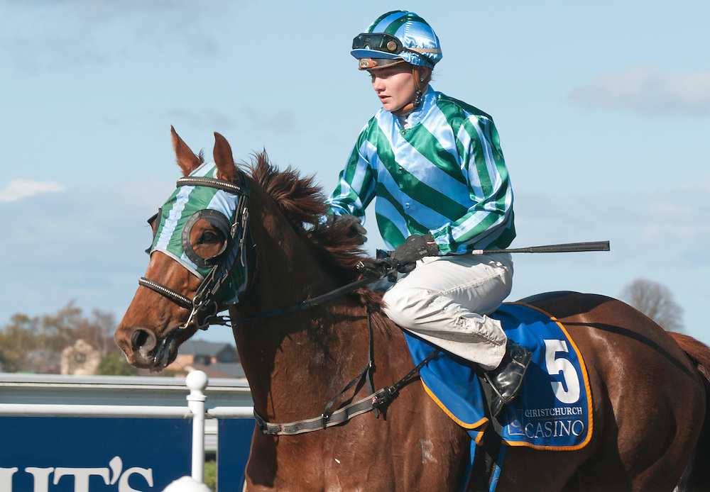 Danielle Johnson, left,  on Crystal Duke  returns to scale after winning Race 8, the Christchurch Casino Spring Classic at Riccarton Race Course, Christchurch, New Zealand, Saturday, October 8, 2011. Credit :  SNPA / David Alexander