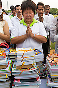 "23 APRIL 2013 - BANGKOK, THAILAND:  People pray during the opening ceremony to mark Bangkok as the World Book Capital City 2013. UNESCO awarded Bangkok the title. Bangkok is the 13th city to assume the title of ""World Book Capital"", taking over from Yerevan, Armenia. Bangkok Governor Suhumbhand Paribatra announced plans that the Bangkok Metropolitan Administration (BMA) intends to encourage reading among Thais. The BMA runs 37 public libraries in the city and has modernised 14 of them. It plans to build 10 more public libraries every year. Port Harcourt, Nigeria will be the next World Book Capital in 2014. <br /> PHOTO BY JACK KURTZ"