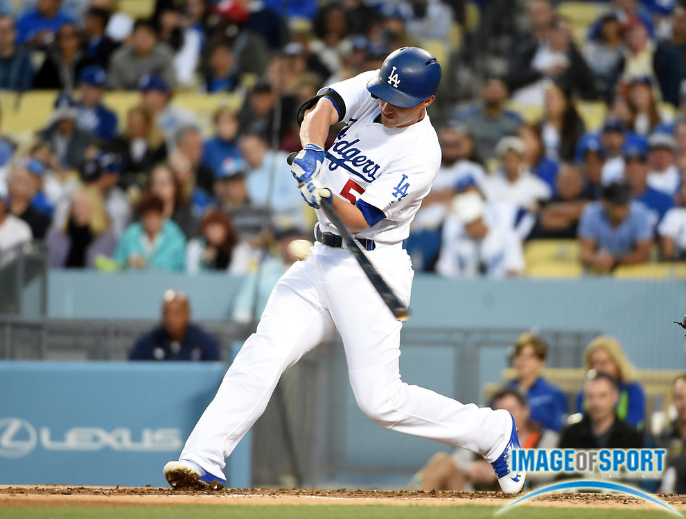 Jun 6, 2016; Los Angeles, CA, USA; Los Angeles Dodgers shortstop Corey Seager (5) bats against the Colorado Rockies during a MLB game at Dodger Stadium.