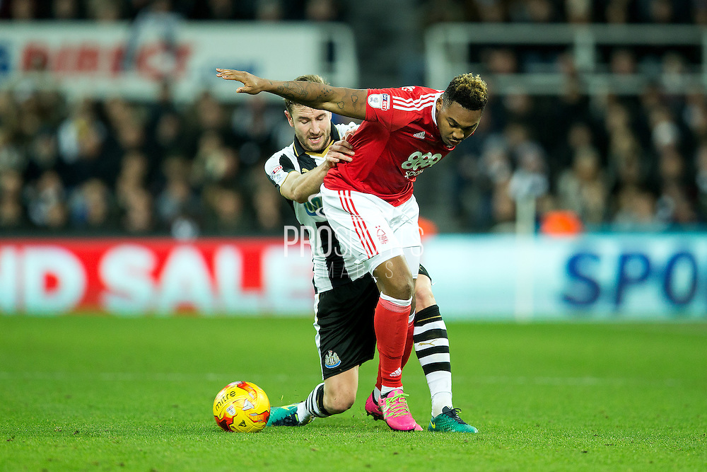 Newcastle United defender Paul Dummett (#3) makes a tackle on Nottingham Forest forward Nicolao Dumitru (#12) during the EFL Sky Bet Championship match between Newcastle United and Nottingham Forest at St. James's Park, Newcastle, England on 30 December 2016. Photo by Craig Doyle.