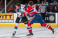 KELOWNA, CANADA - FEBRUARY 17: Rodney Southam #17 of the Kelowna Rockets drops the gloves with Jeff Faith #4 of the Spokane Chiefs during first period on February 17, 2017 at Prospera Place in Kelowna, British Columbia, Canada.  (Photo by Marissa Baecker/Shoot the Breeze)  *** Local Caption ***