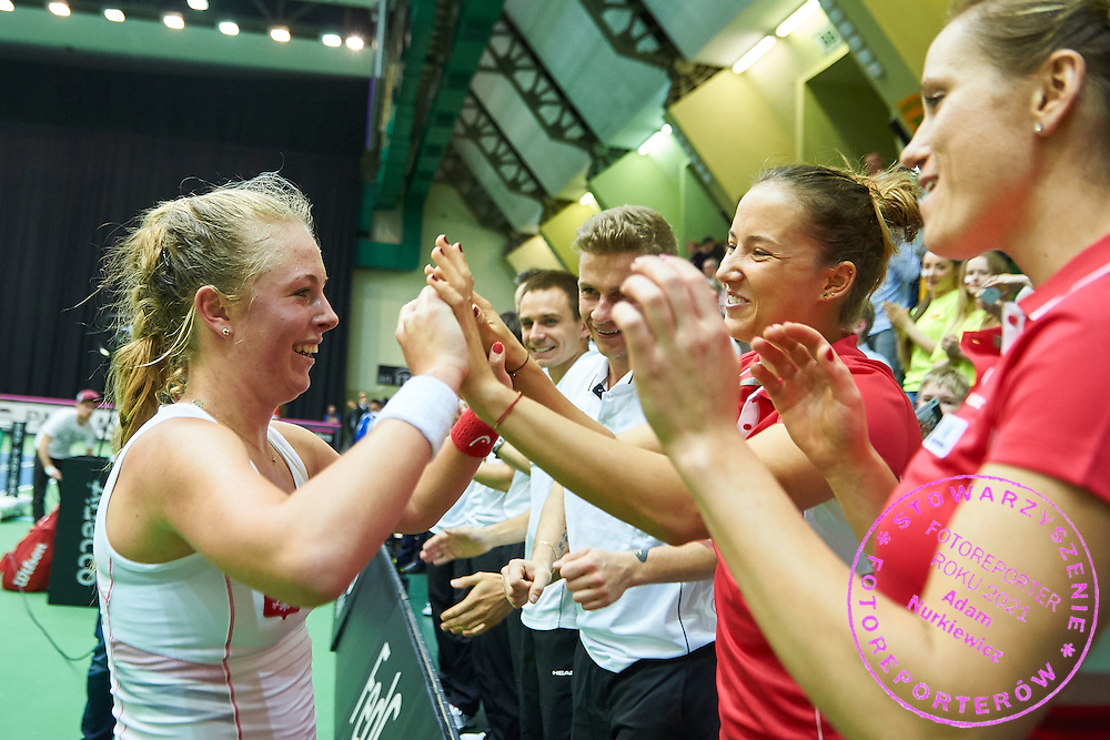 INOWROCLAW, POLAND - 2016 APRIL 16: Magdalena Frech of Poland celebrates her victory with Paula Kania at second women's singles during the Fed Cup / World Group Play Off round tennis match between Poland and Chinese Taipei at OSiR Hall on April 16, 2016 in Inowroclaw, Poland.<br /> <br /> Picture also available in RAW (NEF) or TIFF format on special request.<br /> <br /> Any editorial, commercial or promotional use requires written permission.<br /> <br /> Adam Nurkiewicz declares that he has no rights to the image of people at the photographs of his authorship.<br /> <br /> Mandatory credit:<br /> Photo by &copy; Adam Nurkiewicz / Mediasport