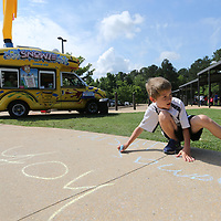 Mac Wilemon, 9, gets to color on the sidewalk at Lawndale Elementery School as they have a fun day to celebrate the last day of school in Tupelo.