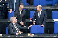 21 MAR 2019, BERLIN/GERMANY:<br /> Horst Seehofer (L), CSU, Bundesinnenminister, und Olaf Scholz (R), SPD, Bundesfinanzminister, im Gespraech, vor Beginn der Bundestagsdebatte zur Regierungserklaerung der Bundeskanzlerin zum Europaeischen Rat, Plenum, Deutscher Bundestag<br /> IMAGE: 20190321-01-009<br /> KEYWORDS: Gespräch