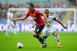 Man Utd Defender Phil Jones (ENG) is challenged by Swansea Midfielder Wayne Routledge (ENG) during the first half of the match - Photo mandatory by-line: Rogan Thomson/JMP - Tel: Mobile: 07966 386802 17/08/2013 - SPORT - FOOTBALL - Liberty Stadium, Swansea -  Swansea City V Manchester United - Barclays Premier League - First round of the 2013/14 season and the first league match for new Man Utd manager David Moyes.