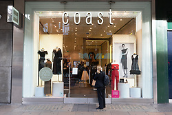 © Licensed to London News Pictures. 12/10/2018. London, UK. A closed Coast clothes stoe on Oxford Street as the company goes into admiinistration. Parts of the business have been bought out by sister company Karen Millen. The deal will save 600 jobs and 145 department-store concessions, but 300 further jobs remain at risk as 24 high-street shops are currently set to close. Photo credit: Ray Tang/LNP
