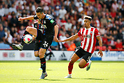 Martin Kelly of Crystal Palace controls the ball with Callum Robinson of Sheffield United chasing down during the Premier League match between Sheffield United and Crystal Palace at Bramall Lane, Sheffield, England on 18 August 2019.