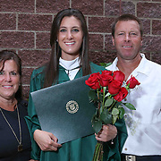 Kendall Parliament, Center, pose for a photo with her parents after Wilmington University commencement exercise Sunday, May 17, 2015, at Chase Center On The Riverfront in Wilmington Delaware.