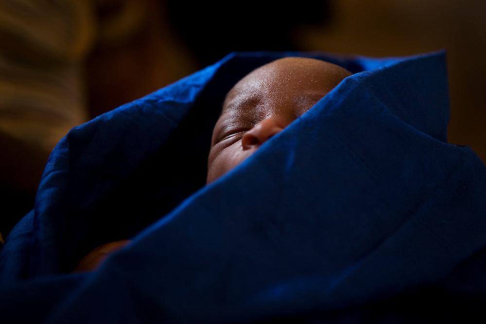 Newborn baby boy in Kroo Bay clinic, dec 2008..Kroo Bay, Freetown, Sierra Leone.