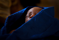 Newborn baby boy in Kroo Bay clinic, dec 2008..Kroo Bay, Freetown, Sierra Leone.