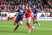 Walsall's Tom Bradshaw battles for the ball with Bury's Peter Clarke during the Sky Bet League 1 match between Walsall and Bury at the Banks's Stadium, Walsall, England on 5 September 2015. Photo by Shane Healey.