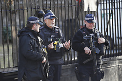 © Licensed to London News Pictures. 11/12/2018. London, UK. Armed police stand guard inside the Carriage Gate entrance to Parliament after an intruder was arrested. Prime Minister Theresa May is touring European countries today in a bid to obtain changes to the Brexit withdrawal agreement. Photo credit: Peter Macdiarmid/LNP