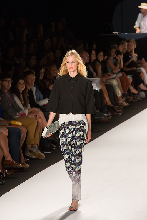 Pants with a panelled floral print, faded at the bottom of the leg, and a half sleeve black top with Peter Pan collar.