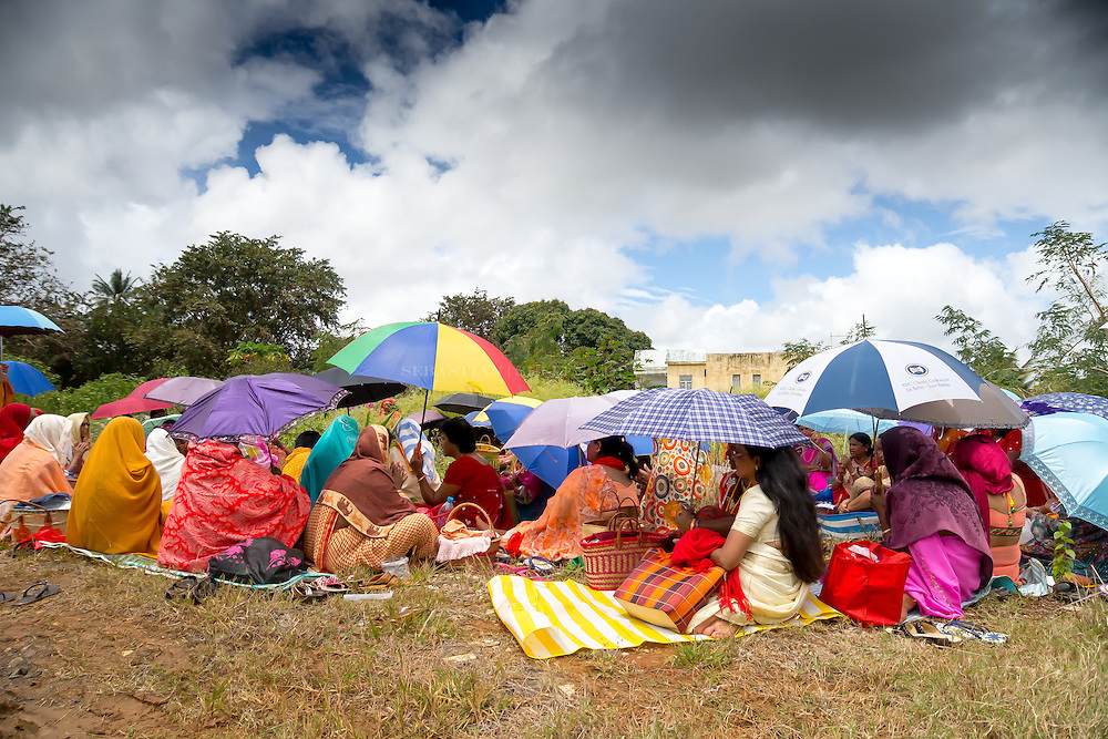 The beautiful Mauritius women relaxing under the sun having tea and conversation Exploring the beautiful island of Mauritius. photographing the people, culture, and food. What a breathtaking country.