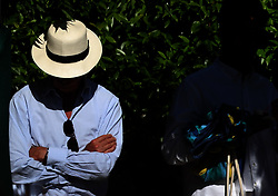 Fan waits to take his seat during day one of the Aspall Classic at the Hurlingham Club, London.