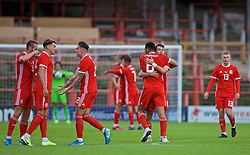 WREXHAM, WALES - Friday, September 6, 2019: Wales' Dante Rigo (L) and Wales' Robbie Burton celebrate at the final whistle during the UEFA Under-21 Championship Italy 2019 Qualifying Group 9 match between Wales and Belgium at the Racecourse Ground. Wales won 1-0. (Pic by Laura Malkin/Propaganda)