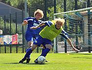 06-08-2008 Voetbal:Maikel Aerts:Bad-Schandau:Duitsland<br /> Willem II is in Oost Duitsland in Bad-Schandau voor een trainingskamp.<br /> Frank Demouge wordt fel op de huid gezeten door Arjan Swinkels<br /> <br /> foto: Geert van Erven