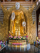 07 OCTOBER 2014 - GEORGE TOWN, PENANG, MALAYSIA: The Buddha at the Dhammikarama Burmese Temple, the largest Burmese temple in George Town (also Georgetown), the capital of the state of Penang in Malaysia. The temple was developed in 1803. Named after Britain's King George III, George Town is located on the north-east corner of Penang Island. The inner city has a population of 720,202 and the metropolitan area known as George Town Conurbation which consists of Penang Island, Seberang Prai, Kulim and Sungai Petani has a combined population of 2,292,394, making it the second largest metropolitan area in Malaysia. The inner city of George Town is a UNESCO World Heritage Site and one of the most popular international tourist destinations in Malaysia.         PHOTO BY JACK KURTZ