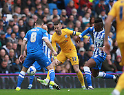 Preston North End striker Paul Gallagher shields the ball from Brighton central midfielder Andrew Crofts and Brighton central midfielder Rohan Ince during the Sky Bet Championship match between Brighton and Hove Albion and Preston North End at the American Express Community Stadium, Brighton and Hove, England on 24 October 2015. Photo by Bennett Dean.