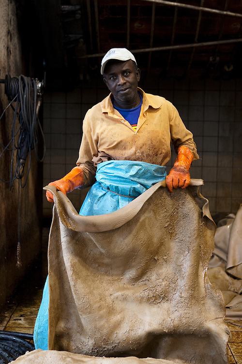 Santa Croce Sull'Arno, Italy. Alcyone tannery SPA. Portrait of a worker during the extraction of the skins from tannery-drums after tanning phase.