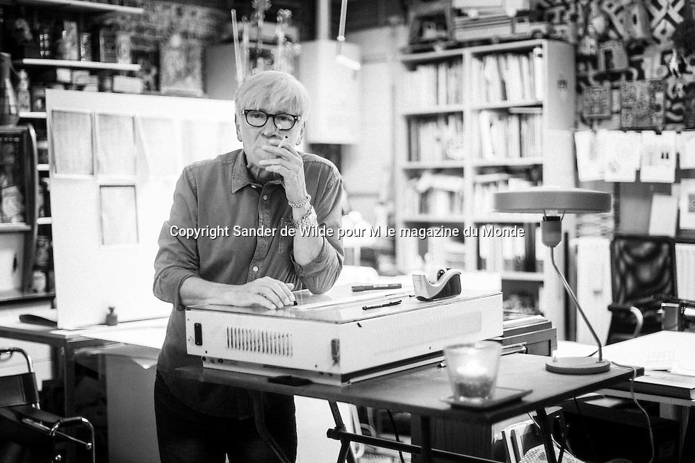 Brussels, Belgium 29 August 2014. Johan De Moor, famous Belgian cartoonist and son of Bob De Moor, right hand of Tintin's Hergé smokes a cigarette in his studio. © Sander de Wilde pour M le magazine du Monde