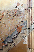 wall with carved graffiti where the stairs have been removed