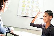 Contagem_MG, Brasil...Aluno atendido no contraturno na sala de recursos para alunos com necessidades especiais. Na foto, ele esta jogando um jogo chamado Pulga Surda, cada casa do tabuleiro pede que ele faca determinado movimento com as maos. A atividade trabalha o condicionamento das maos que e um aspecto fundamental na aprendizagem da lingua de sinais...Student attended the in the resource room for students with special needs. In the photo, he is playing a game called Pulga Surda, in this game He needs to do a particular movement with the hands. The activity works the conditioning of the hands which is a fundamental aspect of learning sign language.. .Foto: LEO DRUMOND / NITRO
