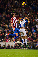Atletico de Madrid's player Diego Godín and RCD Espanyol player Gerard Moreno during match of La Liga between Atletico de Madrid and RCD Espanyol at Vicente Calderon Stadium in Madrid, Spain. December 03, 2016. (ALTERPHOTOS/BorjaB.Hojas)
