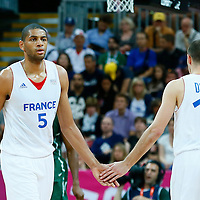 06 August 2012: France Nicolas Batum is replaced by Nando De Colo during 79-73 Team France victory over Team Nigeria, during the men's basketball preliminary, at the Basketball Arena, in London, Great Britain.
