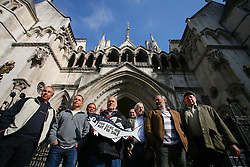 © Licensed to London News Pictures 01/05/2013.A group of fishermen from different parts of Britain, supported by Greenpeace, arrive at the High Court in London to hear the start of a landmark legal case regarding who controls Britain's fishing quota. Large companies control 95% of the quota, in contrast to small scale fishermen who have access to 4% of fishing rights. Large companies are bringing the government to court over its decision to re-locate a small surplus of the fishing quota back to the small scale fishing, which Greenpeace supports as it is more sustainable..London, UK.Photo: Anna Branthwaite/LNP